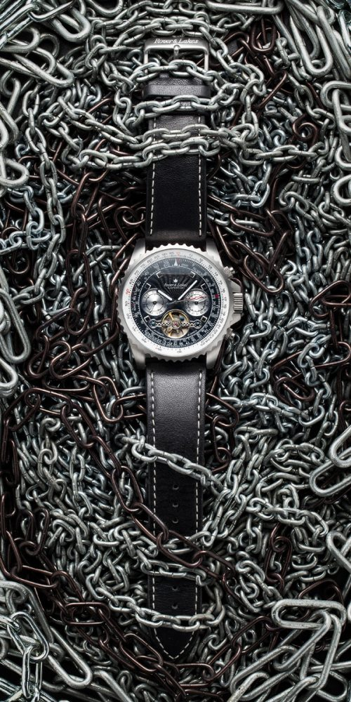 Rover and Lakes Mastertime watch on chains creative product photography